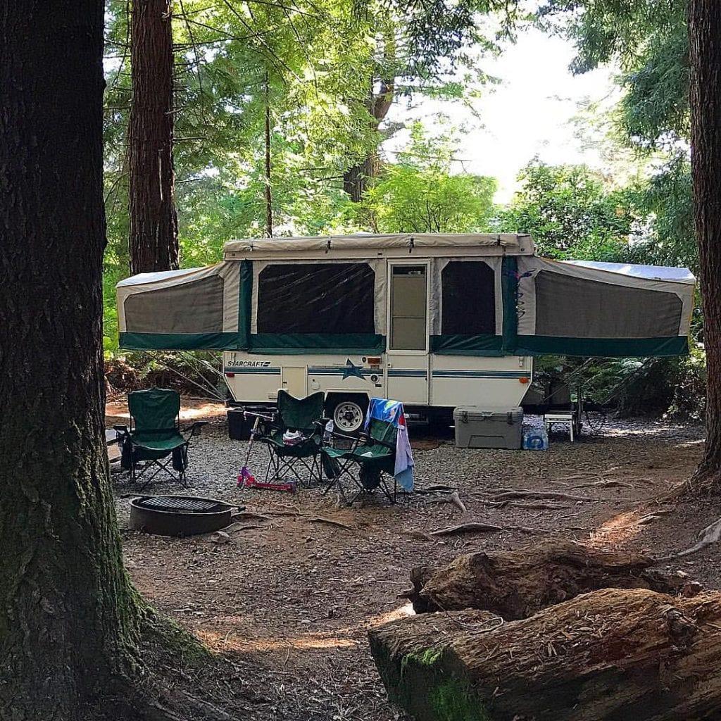 pop up camper in woods